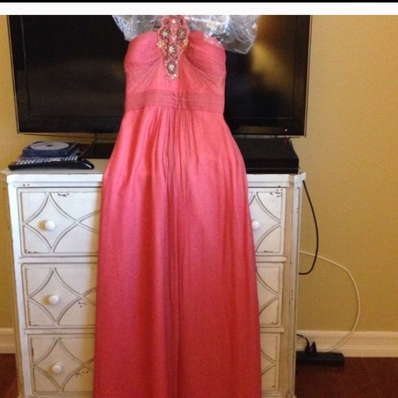 coral formal dress ** Coral floor formal dress, has a ruched body with spaghetti straps, and jeweled neckline. Has never been altered! In very very good condition. Used only once! Aidan Mattox Dresses