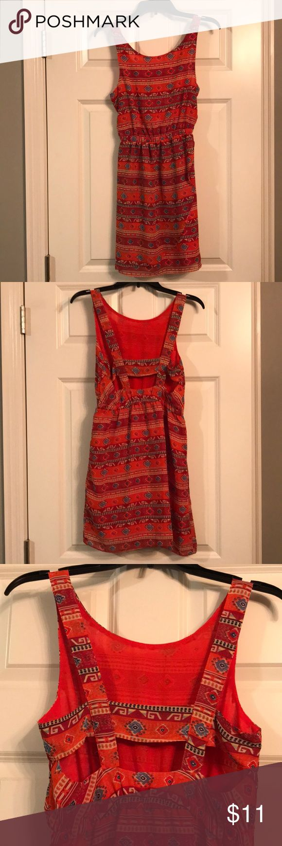Aztec print sleeveless dress NWT! Aztec print dress with lots of detail. Ruffle in front as shown in picture. Open back detail as well. Never worn-Great condition! Cotton Candy Dresses Mini