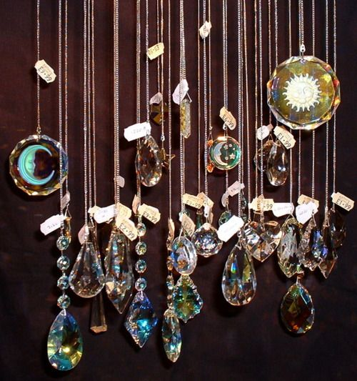 Individual hanging crystals in a dense row. Incorporate with a glass bead curtain or hang in a window!