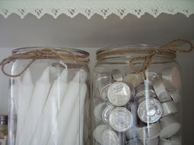 Shelves of candles in jars ♥ Rose petals, too.