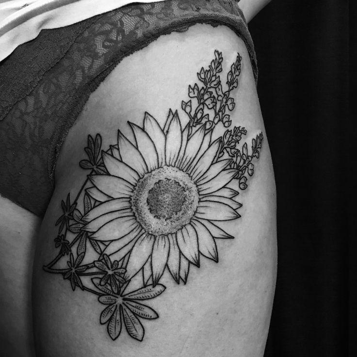 sunflower & lupine upper thigh tattoo