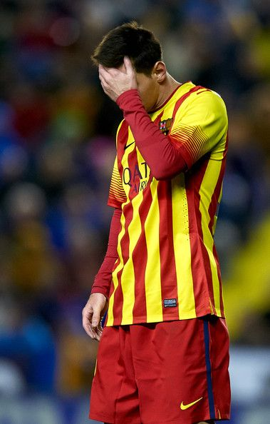 Lionel Messi of Barcelona reacts during the la Liga match between Levante UD and FC Barcelona at Ciutat de Valencia on January 19, 2014 in Valencia, Spain.
