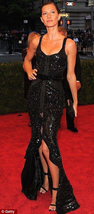 Giselle Bundchen at the Met ball, jet black beaded dress, tan and killer body