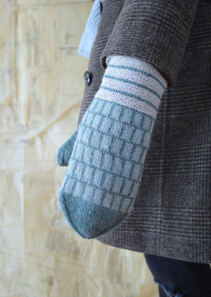 These modern mittens feature a geometric design inspired by the art of painter Agnes Martin. They are worked in the round from the cuff up, in three colors of fingering weight yarn. Find this pattern at LoveKnitting!
