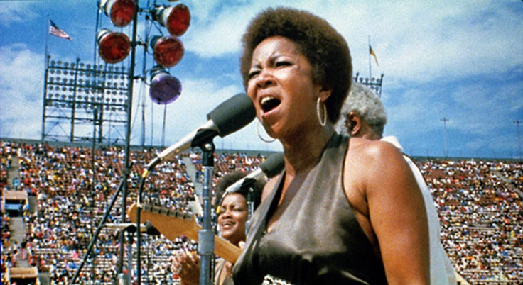 August 20, 1972 — Mavis Staples & The Staple Singers at Wattstax, a concert organized by Memphis' Stax Records to commemorate the seventh anniversary of the Watts riots, held at the Los Angeles Coliseum. Performers included: The Dramatics, Kim Weston, The Emotions, William Bell, The Bar-Kays, Albert King, Little Milton, Johnnie Taylor, Mel and Tim, Carla & Rufus Thomas, Luther Ingram, and Isaac Hayes. A 1973 documentary, Wattstax, is available on DVD.The soundtrack is also available on CD.