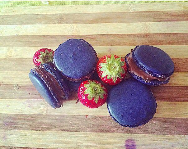 Homemade purple macaron Nutella  and strawberries
