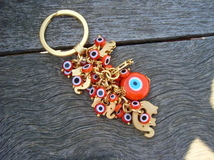 Evil Eye Beaded Keychain with Little Gold Elephant Charms by cocolocca on Etsy (null)