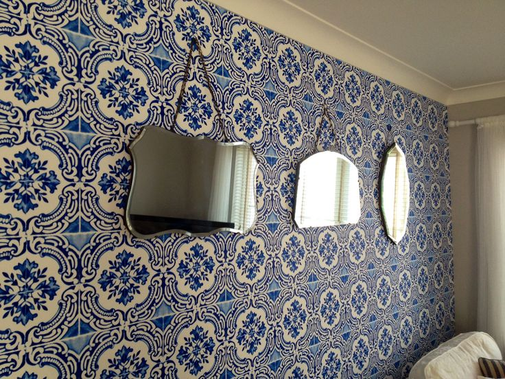 Christian Lacroix for Designers Guild wallpaper. Decorated with vintage mirrors, sourced locally. Moroccan tiled wallpaper.