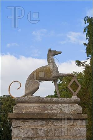 old carved stone greyhound