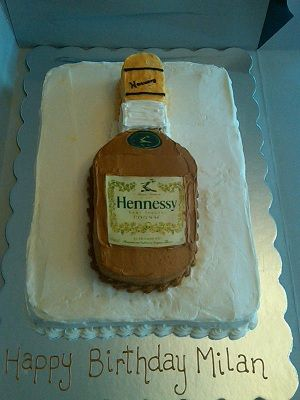Hennessy Bottle Cake - Hand carved bottle with edible image of Hennessy label. The rest of the bottle is buttercream.