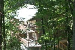Helens Haven Come enjoy the terrific Smoky Mountain views offered at Helens Haven. This #chalet has plenty of windows. Everyone gets the royal treatment with 2 master bedrooms each with its own king bed, vanity area, full bath and more generous windows with a great view. #vacation #gatlinburg
