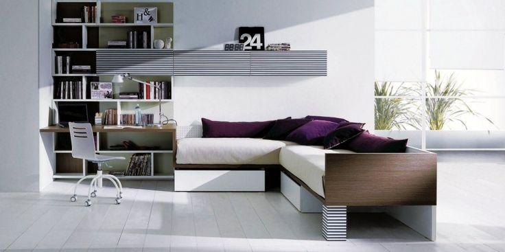Cameretta per ragazzi letto a terra con cassettoni esclusivi,divano,scrittoio e libreria total living.