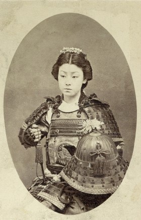 """""""Female Samurai"""", late 1800s. An onna-bugeisha (女武芸者?) was a female warrior. Members of the samurai class in feudal Japan, they were trained in the use of weapons to protect their household, family, and honor in times of war."""