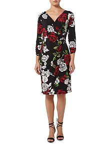 Rose print jersey dress  This just said Pat to me when I saw it.  Shape, sleeve length, hemline all work. But it was the print that drew me to this one it's fun and bold with lots of curves and a connection to nature with the flowers.