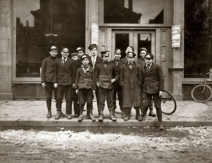 """March 8, 1909. New Haven, Connecticut. """"Telegraph messenger boys. They work until 11 p.m."""" Photo and caption by Lewis Wickes Hine."""