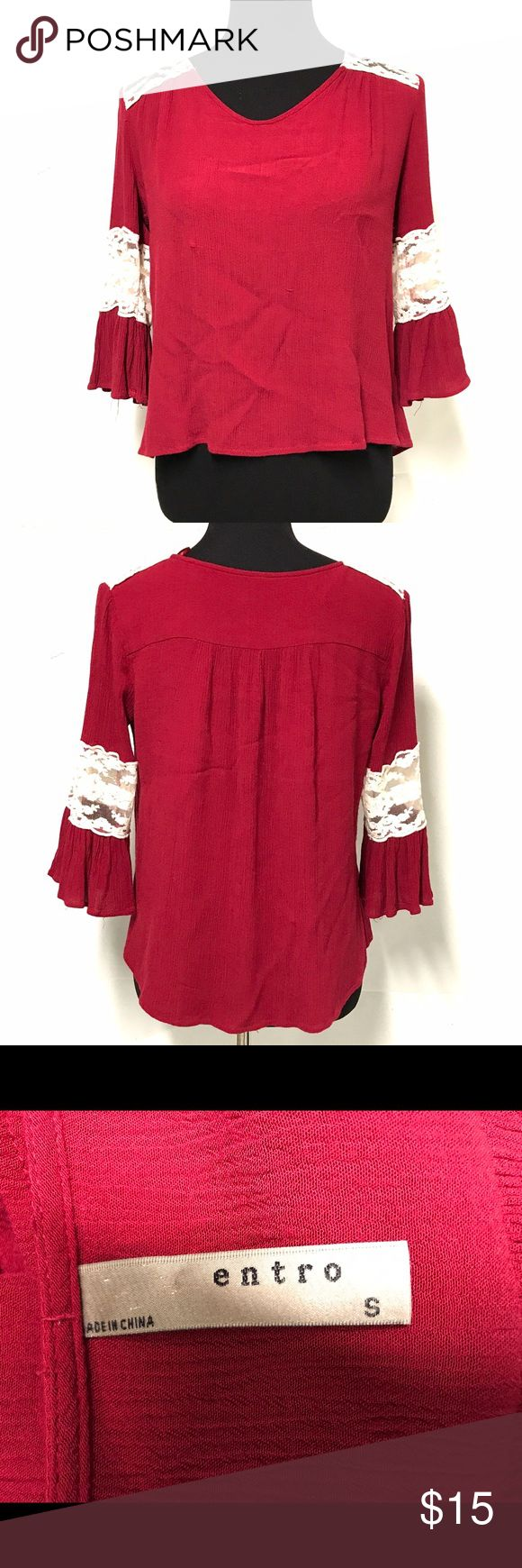 Entro boho red loosely fitting festival shirt Red crepe fabric with 3/4 sleeves and lace understand on the shoulders and arms. It has a subtle high low bottom hem entro Tops Blouses