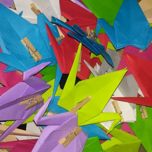 Origami cranes with woodclips