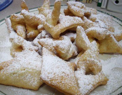 """Ausukes (""""little ears"""" - Lithuanian pastries) 2 eggs 3 tbsp. sweet cream (I substituted whole milk) 1 tbsp. sugar About 1 3/4 cups pastry flour (I used all-purpose)  Beat eggs until light and fluffy. Add sugar and cream. Add enough flour to make a dough which can be rolled very thin. Cut into diamond shapes. Slash the center of each diamond, twist one end through the hole to form a knot. Fry in hot fat until lightly browned. Drain on absorbent paper. Dust with powdered sugar."""
