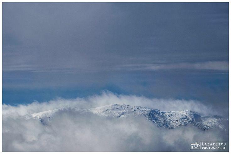 Among the clouds ... - Beautiful landscape of Giumalau mountain peak from Romanian Carpathians mountains in winter seasonn