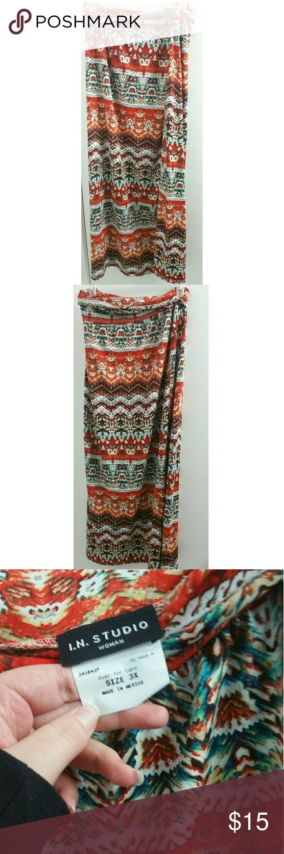 I.N Studio Plus Size Tribal Maxi Skirt This is a 3x size maxi skirt by I.N Studio. There is a slit on the side that goes to almost knee length. The material is soft and silky like athletic leggings or lularoe skirts. It has a vibrant red and blue tribal print however it appears it has belt loops but there is no matching belt. Other than that the skirt is in fantastic condition and is very high quality material. I.N Studio Women Skirts Maxi