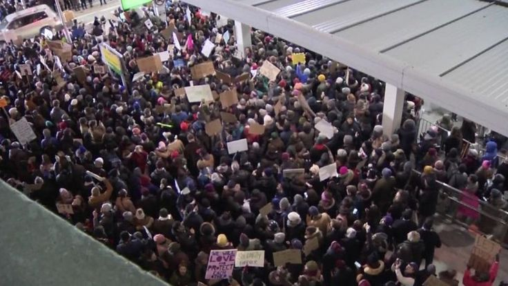 Trump executive order: Calls of 'let them in' at airport protests - BBC News
