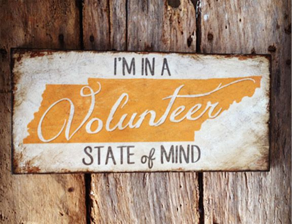 """$38-""""I'M IN A Volunteer STATE of MIND"""" is a wood sign on 30 yr old recycled Tennessee barn wood. * White hand painted background with orange Tennessee state and white text * Size: 18"""" X 8"""". * This sign will look great in any fans home...from the den to the game room to the office, this is sure to show your pride for your team or your love for the great state of Tennessee!"""