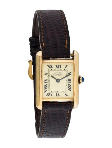 Ladies' 18K yellow gold plated sterling silver Cartier Tank Must de Cartier Watch with smooth bezel, black Roman numeral hour markers, blue-steeled sword hands, brown leather strap and 18K yellow gold-plated stainless steel tang buckle closure.