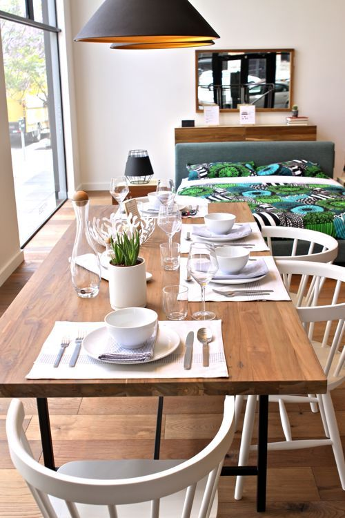 love a simple modern dining room. is that a merimekko bedspread in the background?