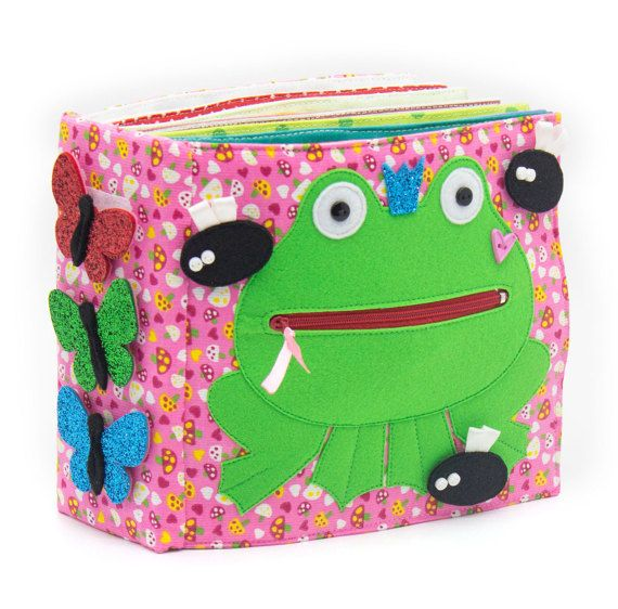 Quiet active book made of cloth is recommended for children from 1 year old. The book has a bag for storage and easy transportation. It consists of 7 sheets. On every of 12 pages there are different kinds of clasps: -Velcro -Buttons -Knobs -Shoelaces -Zipper -Pins -Yarn The hardcover of the quiet active book also contains developing elements on Velcro, mini maze with a ladybird, buttons and ribbons. You can enter any title of the book. Textile developing book is fastened by plenty of…