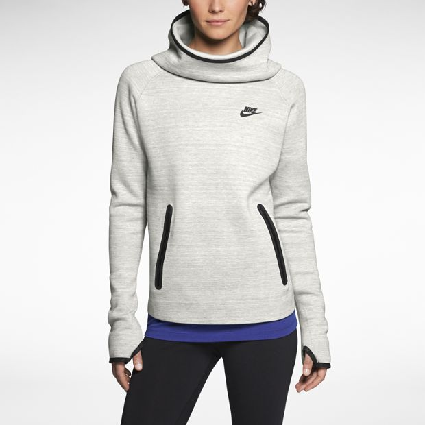The Nike Tech Fleece V2 Women's Hoodie features a light fleece blend and a funnel neck that doubles as a hood for comfort and style that won't weigh you down.