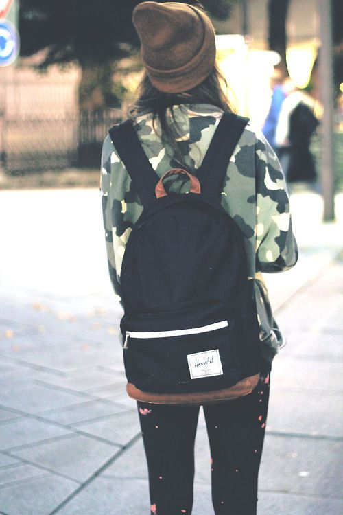 Maybe I should dress like this??? Its not a tshirt but its not a dress!  Plus I love when people wear backpacks!!