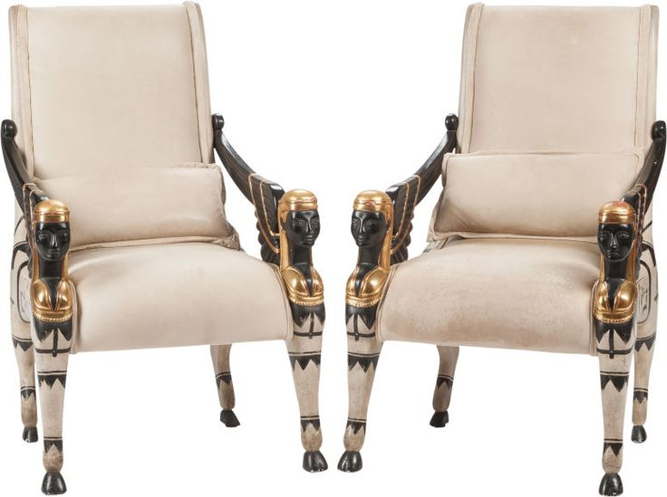 A Pair Of Egyptian Revival Leather Upholstered Ebonized And Parcel Gilt  Armchairs.