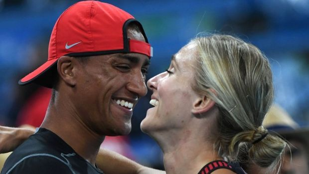 Brianne Theisen Eaton of Canada with husband Ashton Eaton after winning bronze in the women's heptathlon on Day 8 of the Rio 2016 Olympic Games. © @evanmitsu - Brianne Theisen-Eaton stays neutral, cheers for Team North America