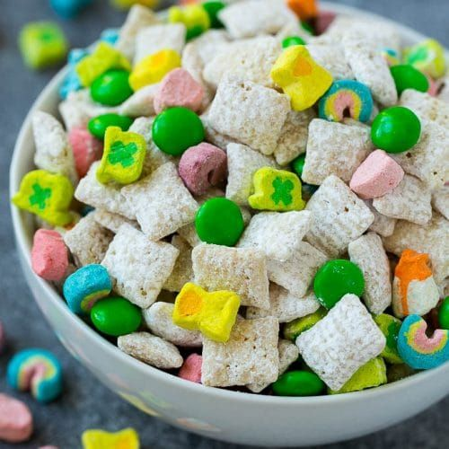 This leprechaun snack mix is a sweet blend of white chocolate muddy buddies, rainbow marshmallows and green M&M candies.