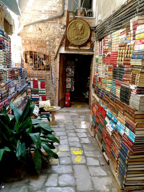 Walk the ancient little streets and wander. Find a treasure of a bookshop like this one in Venice, Italy