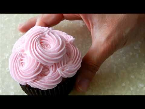 In this video I demonstrate how to pipe a rose swirl, rosettes and a frilly flower on a cupcakes.    Please visit by blog:  http://www.simplysweetsbyhoneybee.com/2012/05/mothers-day-cupcakes-video-tutorial.html    My buttercream recipe can be found here:  http://www.simplysweetsbyhoneybee.com/2012/05/vanilla-almond-buttercream-recipe.html    Find me on ...