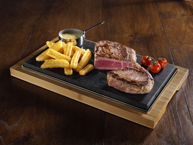 SteakStone - Steak on the Stone is a meal like no other. A meal where you have the opportunity to cook your food exactly as you like. Heat the stone up and serve it with your steak to let it's consumer choose how well done they'd like their steak.