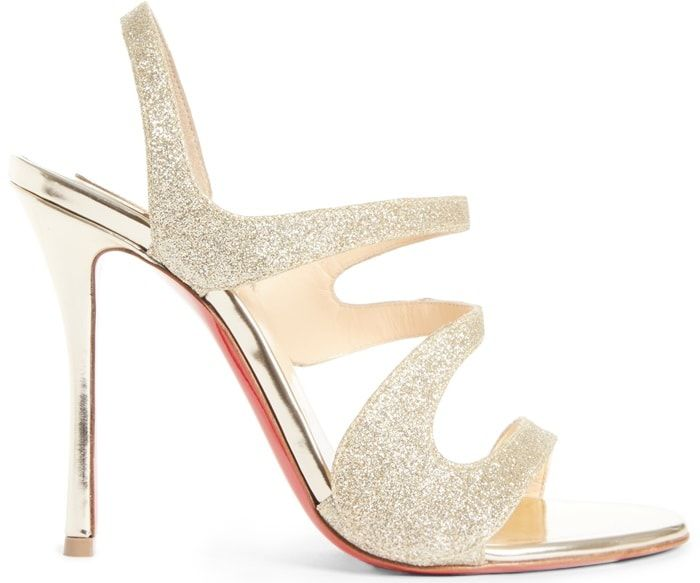 187c8131c8e3 Christian Louboutin s light gold glitter Vavazou sandals feature asymmetric  cutouts and a leg-lengthening specchio leather stiletto heel