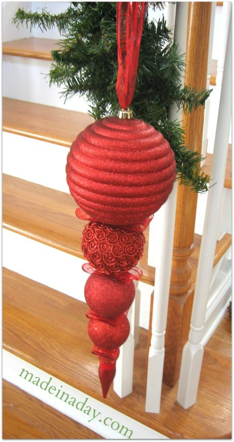 Stack Ornament~ buy varying sized ornaments, hot glue them together with some festive ribbons or greenery, ribbon at the top, viola! extra large finial