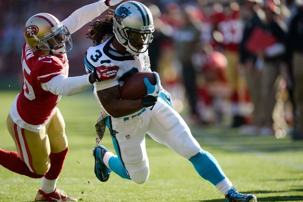 SAN FRANCISCO, CA - NOVEMBER 10: DeAngelo Williams #34 of the Carolina Panthers scores on a twenty-seven yard run, breaking the tackle of Tarell Brown #25 of the San Francisco 49ers during the second quarter at Candlestick Park on November 10, 2013 in San Francisco, California. (Photo by Thearon W. Henderson/Getty Images)