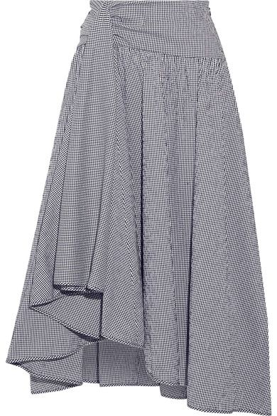 From the Spring '17 collection, Rosie Assoulin's skirt is cut from seersucker in a midnight-blue and white gingham check. This midi style drapes to an asymmetric hem and has inverted pleats for added volume. We'll be wearing ours with an off-the-shoulder top and slides.