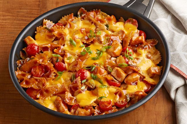 Delight your taste buds with this BBQ Chicken-VELVEETA® Skillet. This cheesy skillet incorporates green onions, cherry tomatoes and bow-tie pasta.