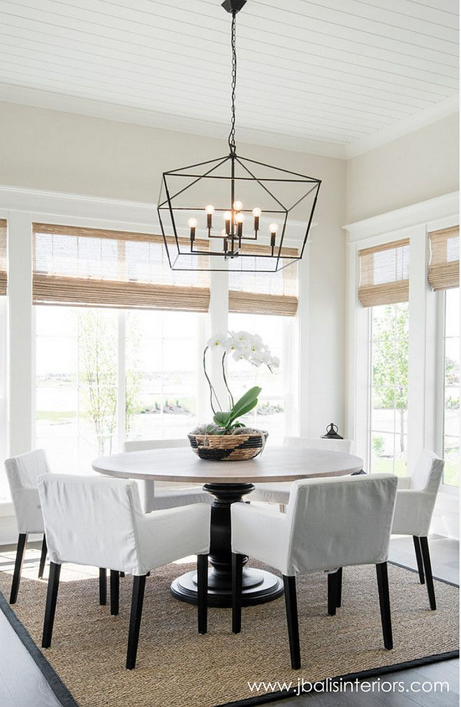 Farmhouse Dining Room With A Simple Design Approach And Stricking Lighting Wall Paint Color Is Classic Gray By Benjamin Moore