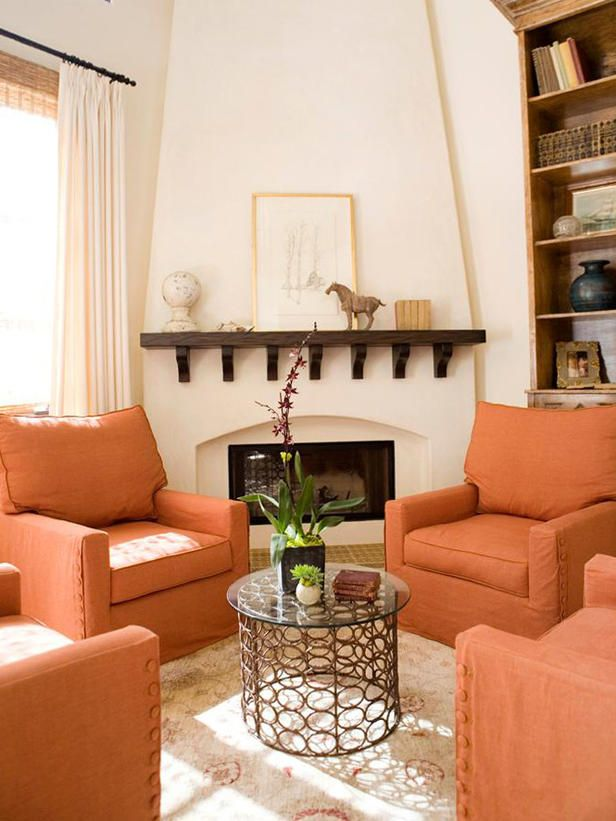 Love this cozy sitting area with the tangerine chairs. Also love the coffee table..