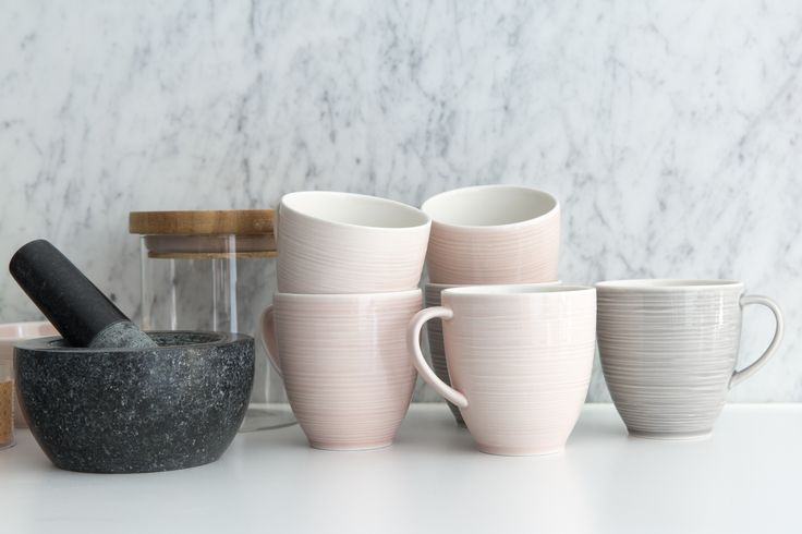Kallio Mug | Designed by Anu Pentik, this mug is a part of Kallio (Rock) tableware series that reflects the human touch. Each part of the series is both powerful and delicate at the same time, which makes us want to touch them so much. Made in Posio, Lapland, these pottery utensils are extremely durable and long-lived. Available in pink, grey and white.