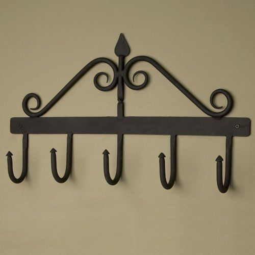 Morley Hand-Forged Iron Coat Rack - Black Powder Coat by Whittington Collection. $32.95. This hand-forged iron coat rack has five hooks to hold your coats, scarves and hats. With decorative swirls above the rack, a twist on the center bar and a classic spade detail at the top, this rack will add character to any entryway. Available in Black Powder Coat finish. Made of cast iron. Overall measurements: 19 L x 11 H. 2-5/8 extension from wall. Includes fastening hardware.