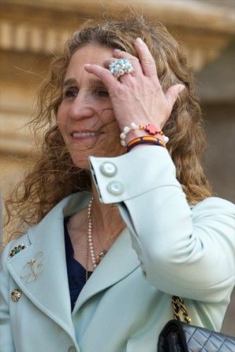 "MONDAY, APRIL 21 The ""look"" of the Infanta Elena   To attend Mass on Easter Sunday in the cathedral of Palma de Mallorca, Infanta Elena wore many jewels: pin, a necklace, a chain with various pendants, but also a big ring bracelets whose with a Spanish flag colors."