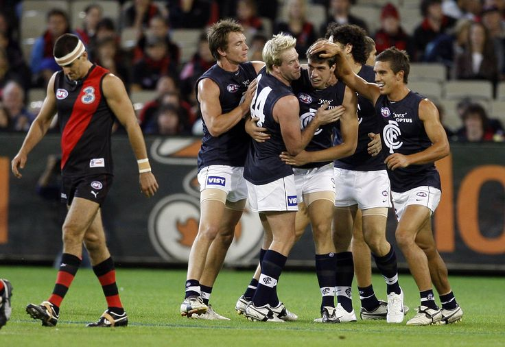 Mobbed by his team mates after kicking his first AFL goal.