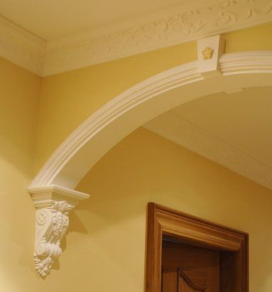 Archway with corbels. Wood corbels, hand carved with many designs, are available from Wild Goose Carvings online at www.buycarvings.com