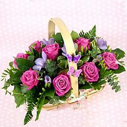 A Charmng Wicker Basket filled with a seasonal choice of flowers and fine…